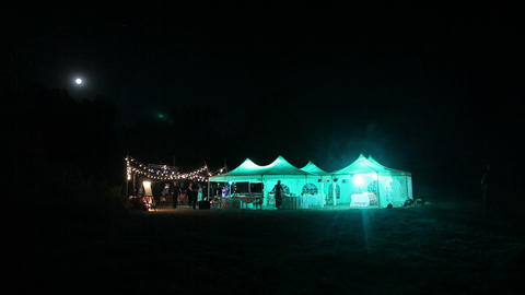 Beautiful wedding tent set up for an outdoor This is a long night exposure Live Action