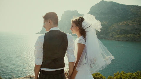 The bride and groom admiring the evening tide Footage