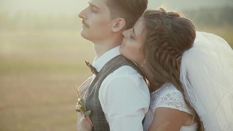 Bride embraces bridegroom Live Action