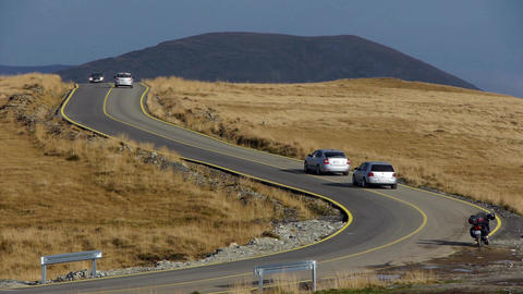 Car traffic on a road serpentine windings in mountains 109a Footage
