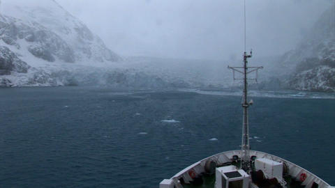 South Georgia: expedition ship passing icebergs and... Stock Video Footage
