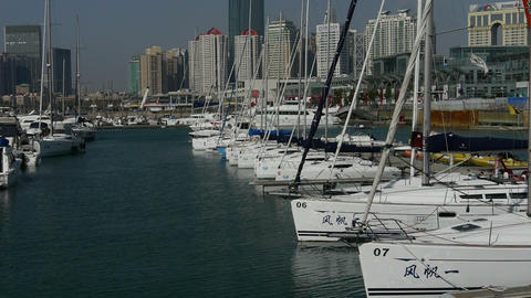 Yacht on the water at Pier of QingDao city Olympic... Stock Video Footage