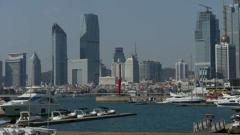 Yacht on the water at Pier of QingDao city Olympic Sailing Center,Torch,tsingtao Footage