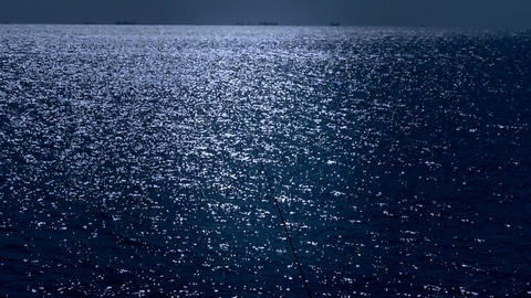 Sparkling water surface and fishing rod,horizon,skyline,night Footage