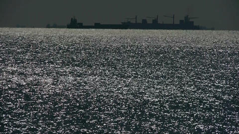 Sparkling water surface and Vessel Ship,horizon,skyline,night Footage