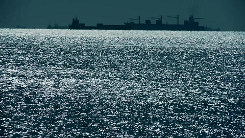 Sparkling water surface and Vessel Ship,horizon,skyline,night Live Action