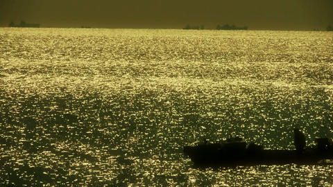 Sparkling water surface and Vessel Ship,horizon,skyline,Gold Live Action