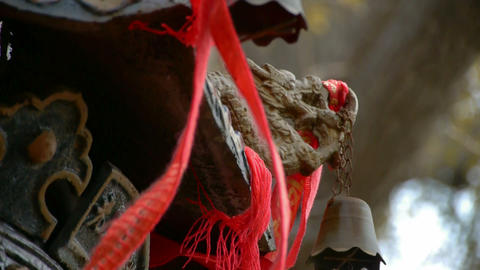 Dragon and metal bell on censer,Red ribbon blowing in wind Stock Video Footage