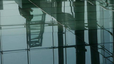Person's shadow,Figure reflection on marble floor at Luxury mall,shadow,hall,ove Footage