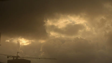 Dark clouds cover sky,Cranes,Sandstorm,building... Stock Video Footage