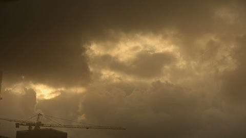 Dark clouds cover sky,Cranes,Sandstorm,building... Stock Video Footage