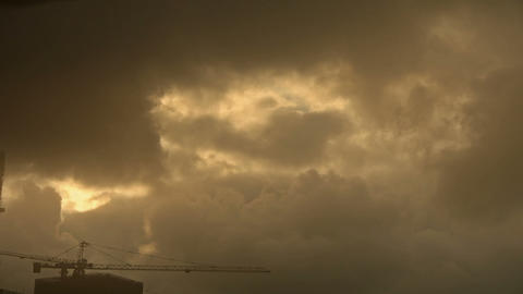 Dark clouds cover sky,Cranes,Sandstorm,building high-rise,House silhouette Footage