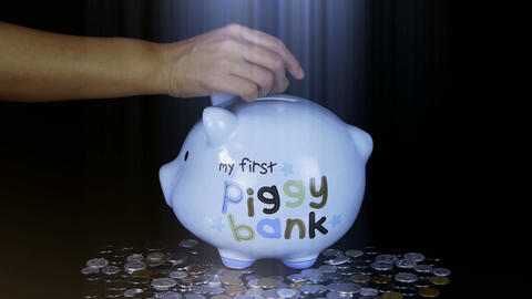 Piggy bank coin drop in black space,Piggy Bank Savings... Stock Video Footage