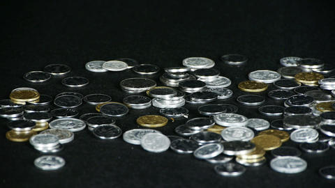 catch a group of coins by hand Stock Video Footage