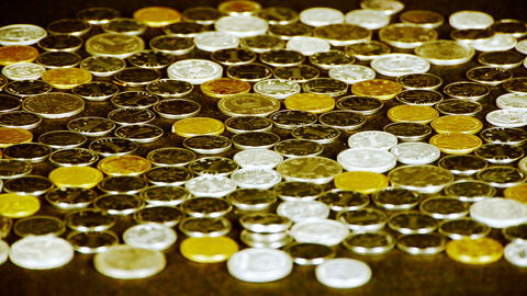 caress golden coins by hand Stock Video Footage