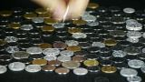 Counting golden coin from a group of money by hand Footage