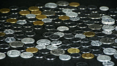 Counting golden coin from a group of money by hand Stock Video Footage