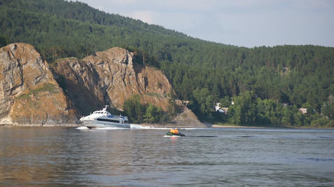 Pleasure and fishing boats sailing on the Yenisei River Stock Video Footage