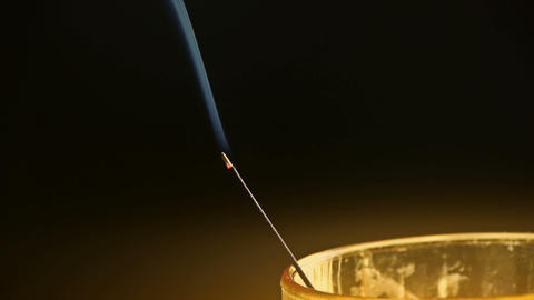 Smoke-filled burning incense in space,Soot and golden lights Stock Video Footage