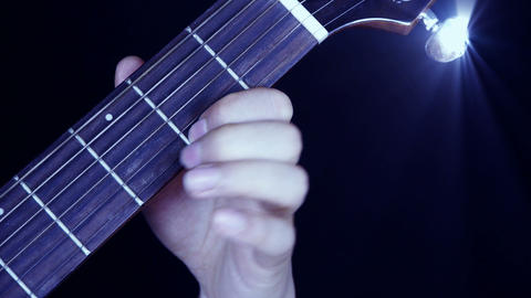 playing guitar,strum,disco rays lights Stock Video Footage
