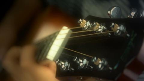playing guitar,strum,doft warm lights Stock Video Footage