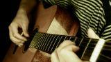 playing guitar,strum,retro style Footage