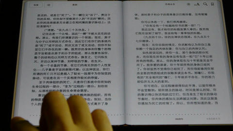 chinese Book on a touch screen tablet computer Stock Video Footage