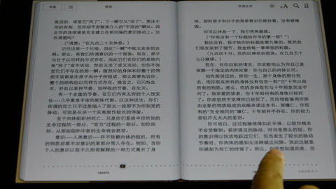 chinese Book on a touch screen tablet computer Footage