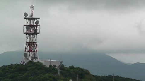 Telecommunication Tower among Tropical Hills Stock Video Footage
