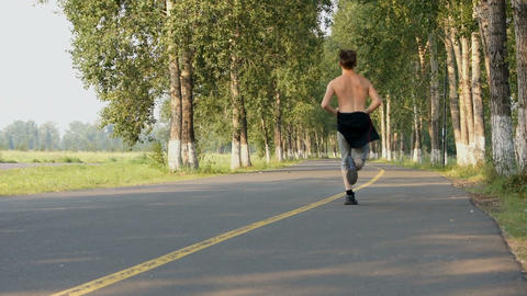 Running Young Man in the Park Stock Video Footage
