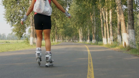 Young Blonde Woman Riding On Roller Skates Stock Video Footage