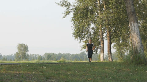 Young Woman Running in the Park Stock Video Footage
