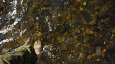 Military cross barefoot a mountain river 41a Footage