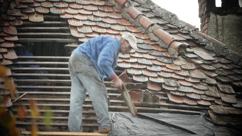 Workers covering a roof with tile 02 Footage