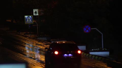 Car traffic on a rainy night 02 Footage