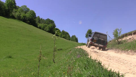 Off road vehicle running on a country road 106 Footage