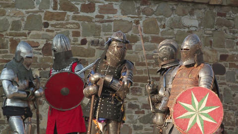2546 knights in armor stand in a fortress during the day Footage