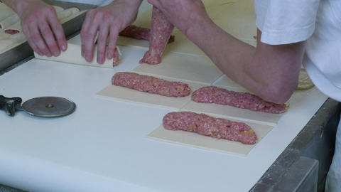 german baker making meat roll bun 11748 Footage