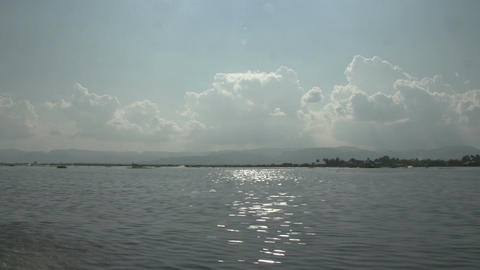 Inle lake, floating on lake and mountains on background Live Action
