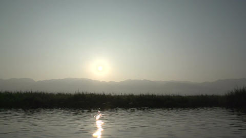 Nyaung Shwe, POV from boat on floating island at sunrice Footage