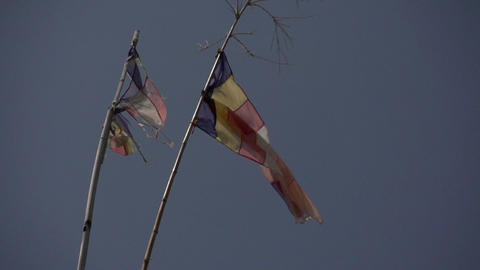 Nyaung Shwe, Buddhist flags on blue sky Live Action