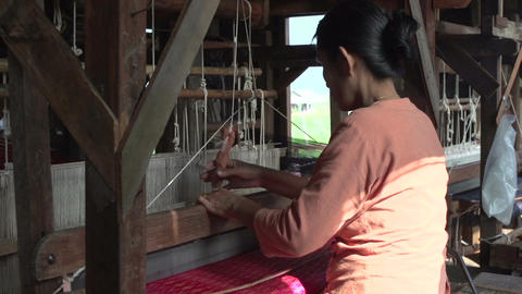Nyaung Shwe, woman working with silk weaving Footage