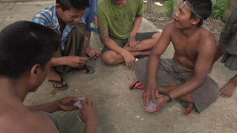 Pathein, men playing card game on the street Live Action