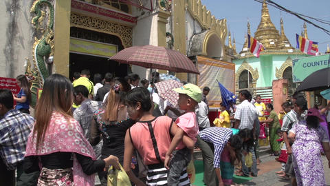 Yangon, people at entrance of pagoda Live Action