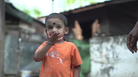 Yangon, little boy gives kiss hand Live Action