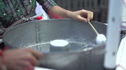 Yangon, making candy twist at fair Live Action