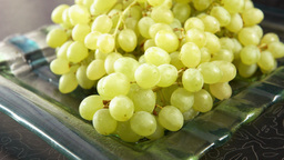 Green Bunch Of Grapes Lying On A Platter stock footage
