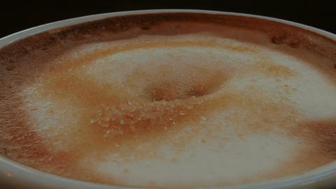 Adding Sugar to Caffe Latte Ultra Macro Shot Footage