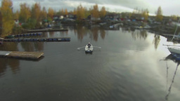 man in a rowing boat aerial view Footage