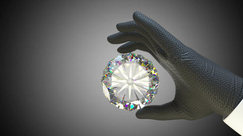 Hand in glove holding huge gemstone or diamond with alpha matte Animation